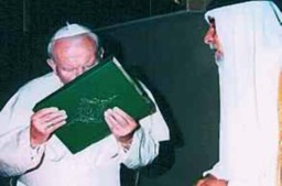 John Paul II kissing the Koran.